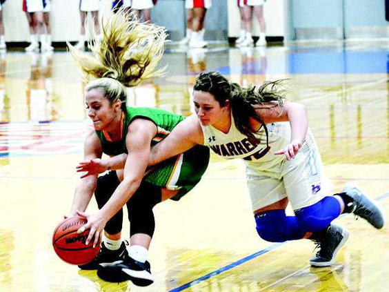 Lady Pioneers fight for ball --